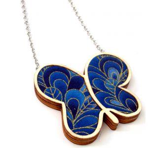 Királykék pillangó csillogó arany kontúrral